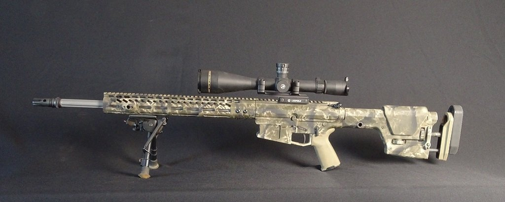 The camo on this AR was made with an air brush over foliage