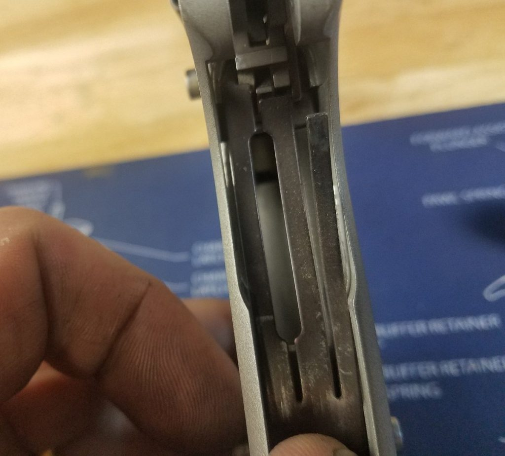 cleaning colt 1911 pistols, installing the leaf spring into the grip