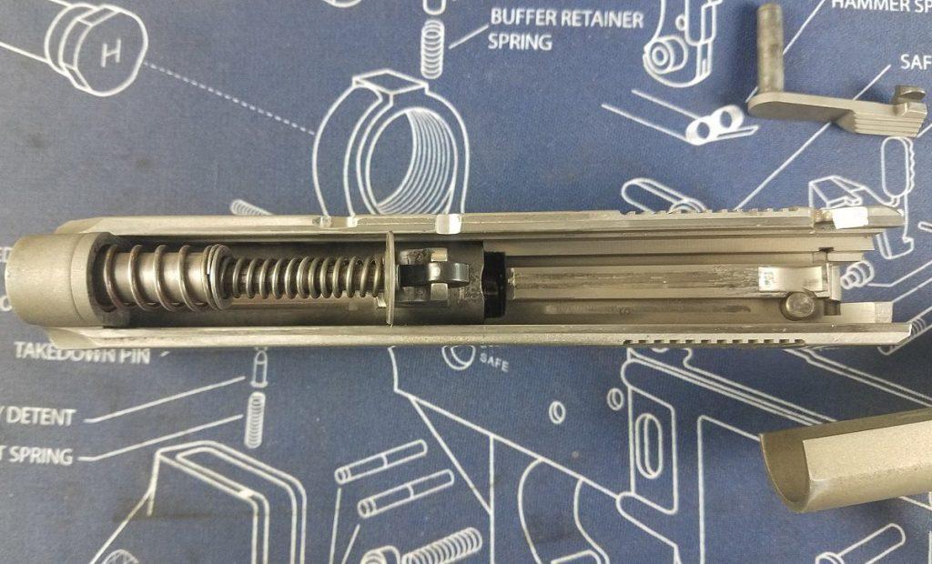 Colt Defender slide showing recoil spring and barrel