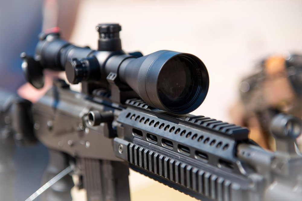 how to attach a camera to a rifle scope